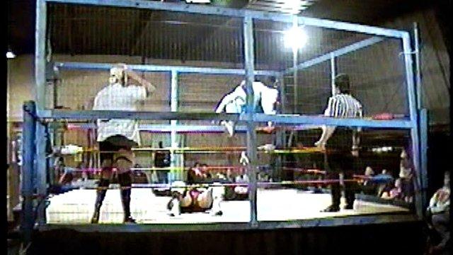Cage Match Beau James and Steve Flynn vs. Buddy Landel and Ricky Harrison