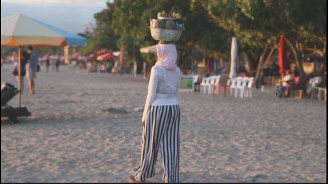 Balinese woman in the beach