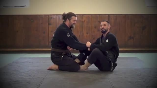 Shoulder Roll Arm Bar from a Butterfly Drag