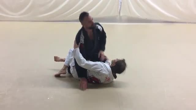 Step Over Lapel Choke From Half Guard