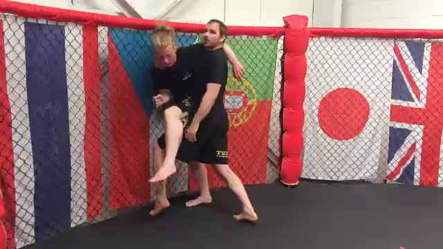 Leg Weave Takedown Against The Cage