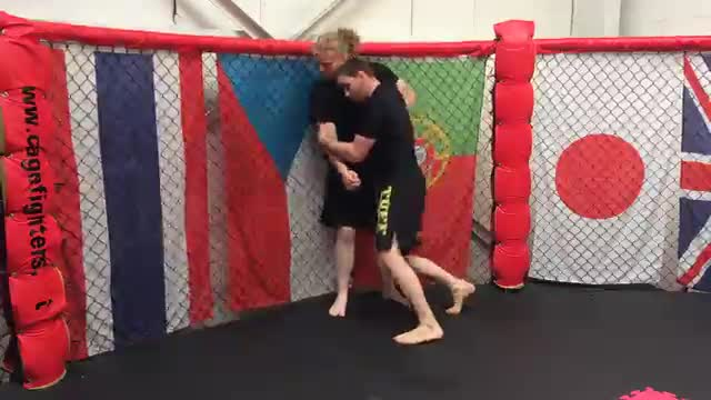 Collapsing The Leg From The Double Leg Against The Cage