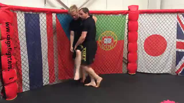 Footsweep Takedown Against The Cage