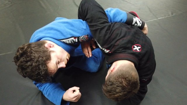 Back Escape > Half Guard Sweep