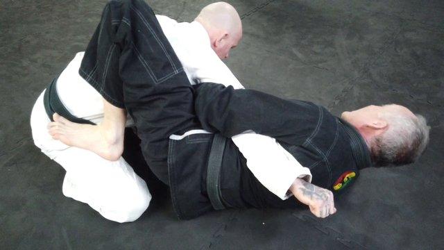 Closed Guard Punch Choke/Armbar > Punch Choke Sweep > Step Over Sweep [Gi]