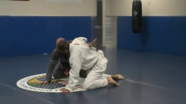 Straight arm lock from side mount; half guard