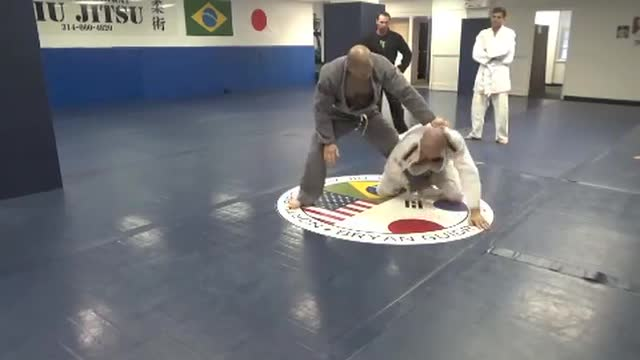 Closed guard sweep to arm bar