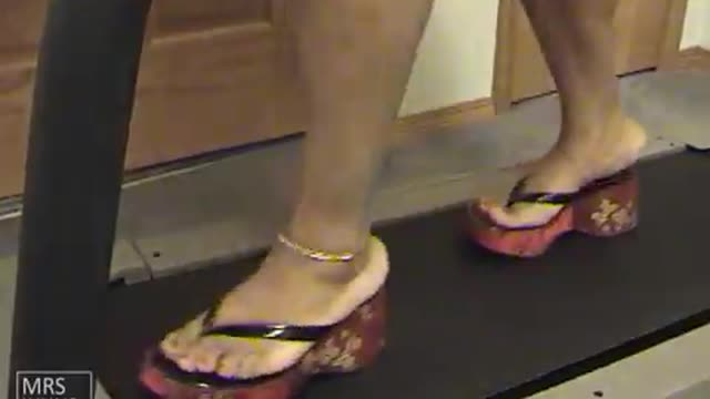 Walking On The Treadmill In Red Platform Flip Flops
