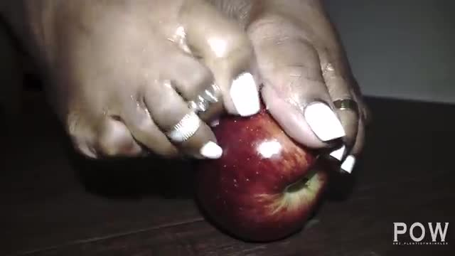 Scratching An Apple With Her Toenails