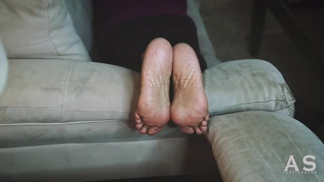Soles On The Arm Of The Couch